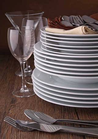 pile of plates and cutlery photo