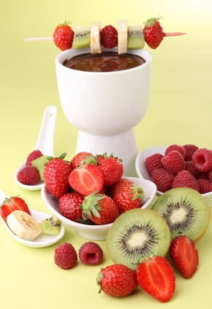 delicious chocolate fondue with fruits photo