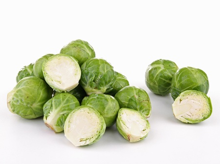 brussels sprouts: isolated uncooked brussels sprouts on white Stock Photo
