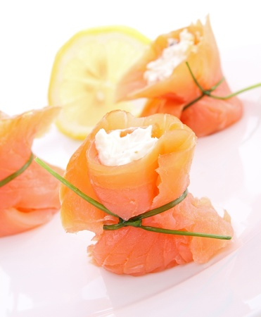 appetizer, roll salmon with cheese photo