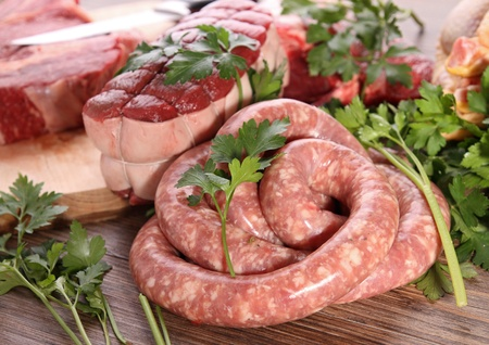 sausage, roast beef and rib beef with parsley photo