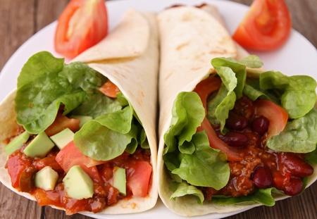 fajitas burritos with beef and vegetables photo
