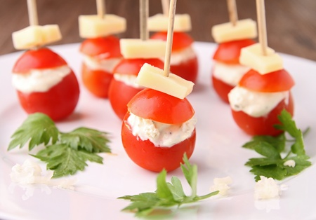 cherry tomato: appetizer,cherry tomato and cheese Stock Photo