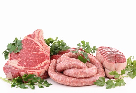 meats: isolated raw meats and parsley on white