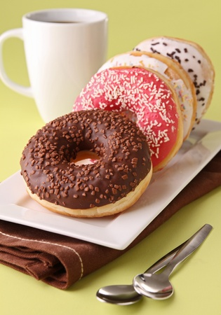 donuts and coffee cup photo