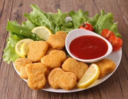 plate of nuggets and salad