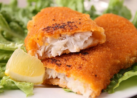 cooked fish: fried fish and salad