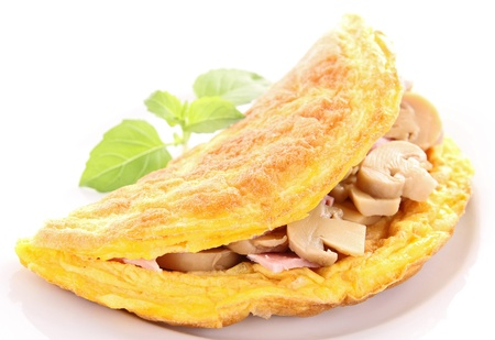 an omelette: tasty omelette with mushroom