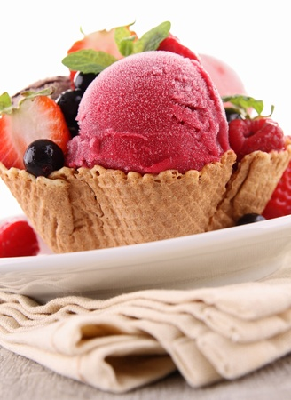 scop of ice cream and berries photo