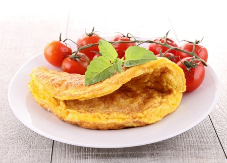 omelette: omelette and cherry tomato Stock Photo