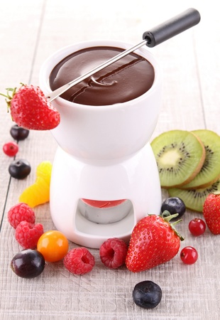 chocolate fondue and fruits photo