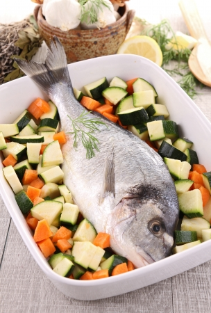 raw sea bream and vegetable photo