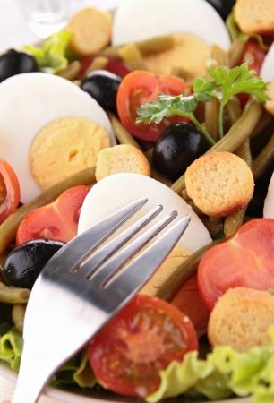 mixed salad and fork photo