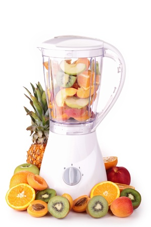blender with assortment of fruits photo