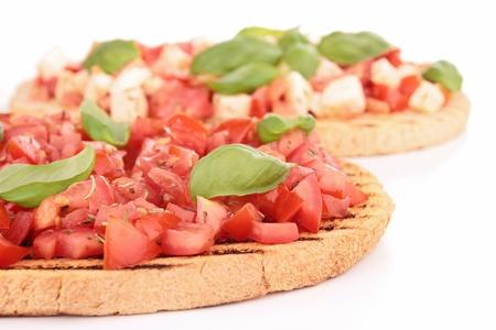 bruschetta with tomato, mozzarellla and basil photo