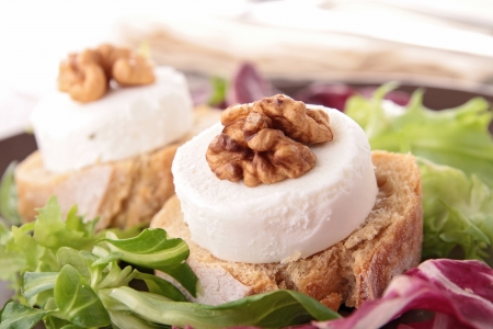 goat cheese: bread with goat cheese and walnut Stock Photo