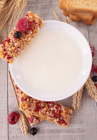 bowl of milk with granola and berries fruit photo