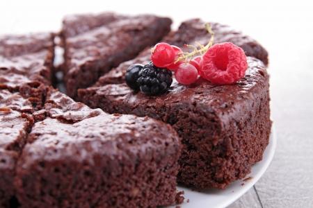 indulgence: chocolate pie and berries fruit Stock Photo