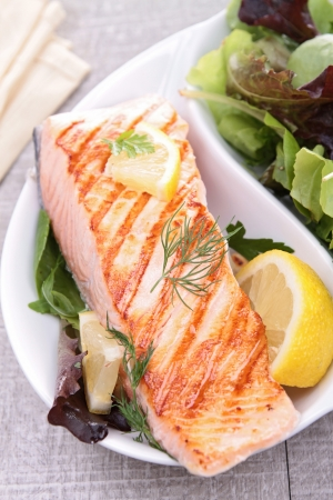 salmon dinner: grilled salmon and vegetables Stock Photo