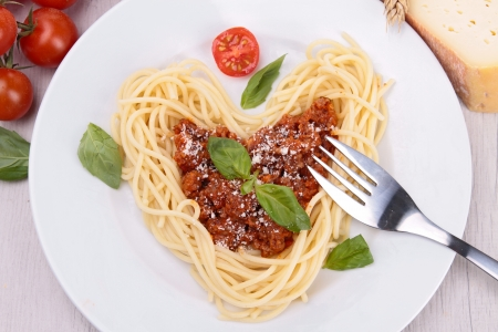 spaghetti with bolognese sauce and basil photo