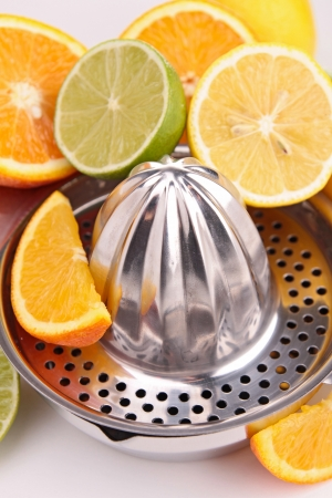 juicer with assortment of fruits Stock Photo