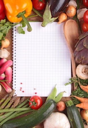 cooking recipe: raw vegetables and notebook Stock Photo
