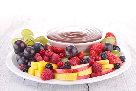 chocolate sauce and assorted of fruits photo