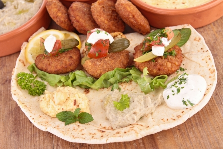 pita bread with falafel and sauce photo