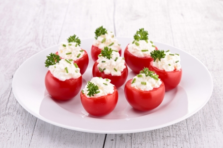 caterer: stuffed cherry tomatoes with cheese