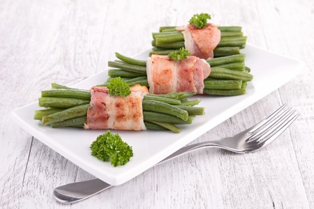 green bean wrapped in bacon Stock Photo