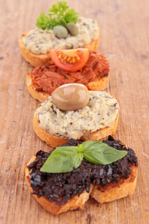 assortment of tapenade toast photo