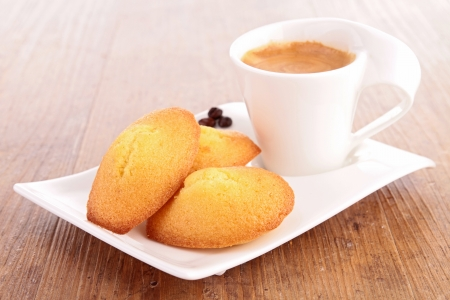 madeleine: coffee cup and madeleine Stock Photo