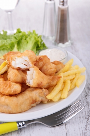 fish and chips with salad and sauce photo