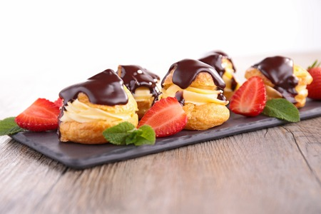profiterole: pastry filling with cream and chocolate sauce