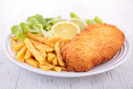 cooked fish: breaded meat and fries