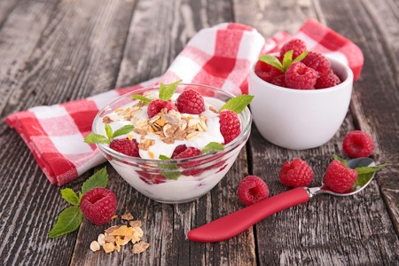 yogurt with muesli and raspberry photo