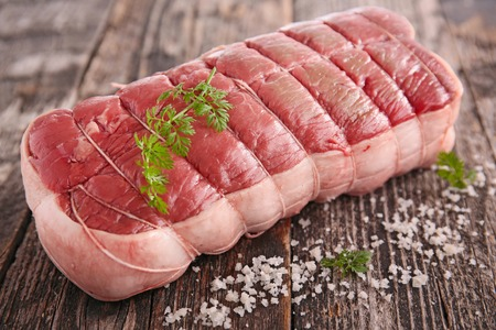 roast beef  on wooden table