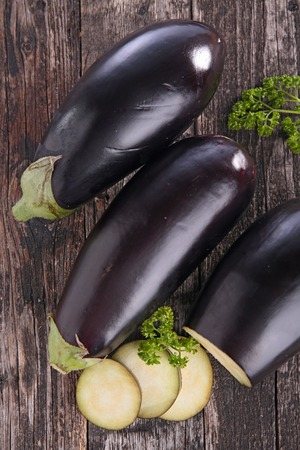 epicure: raw eggplant on board Stock Photo