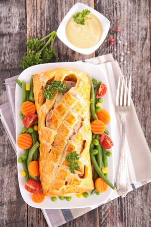 meat pie: meat pie and vegetables Stock Photo