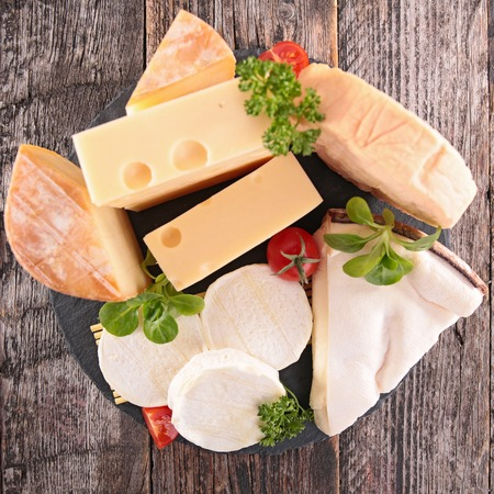 goat cheese: collection of cheese on wood background Stock Photo