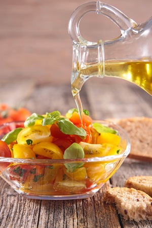 cooking oil: tomato salad and cooking oil Stock Photo