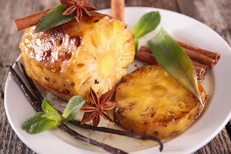 epicure: pineapple roasted and spices Stock Photo