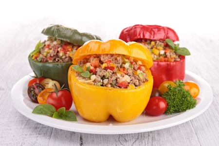 baked bell peppers stuffed with vegetable and meat