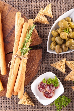 breadstick: buffet food with olive,breadstick and salami
