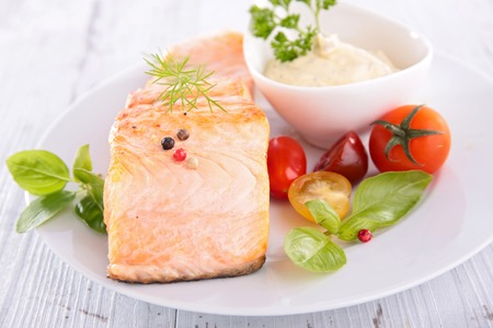 epicure: salmon,sauce and tomato Stock Photo