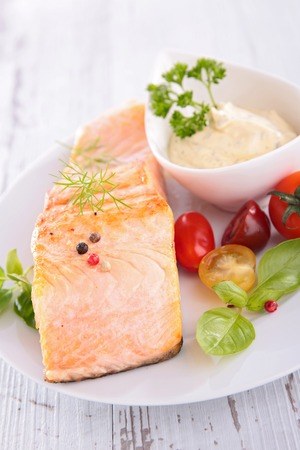 epicure: salmon,sauce and tomato Stock Photo