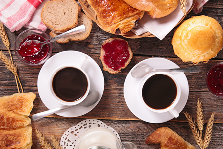 breakfast cup: breakfast with coffee cup and pastries Stock Photo