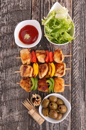 kebob: grilled barbecue meat with lettuce and olives