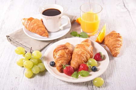 croissants: breakfast with coffee,croissant and fruits Stock Photo