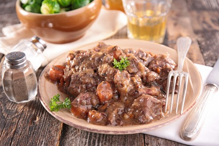 wine sauce: meat cooked with wine sauce and vegetable Stock Photo